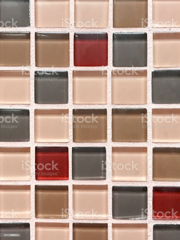 red and rose gold square glass tile surface stock photo