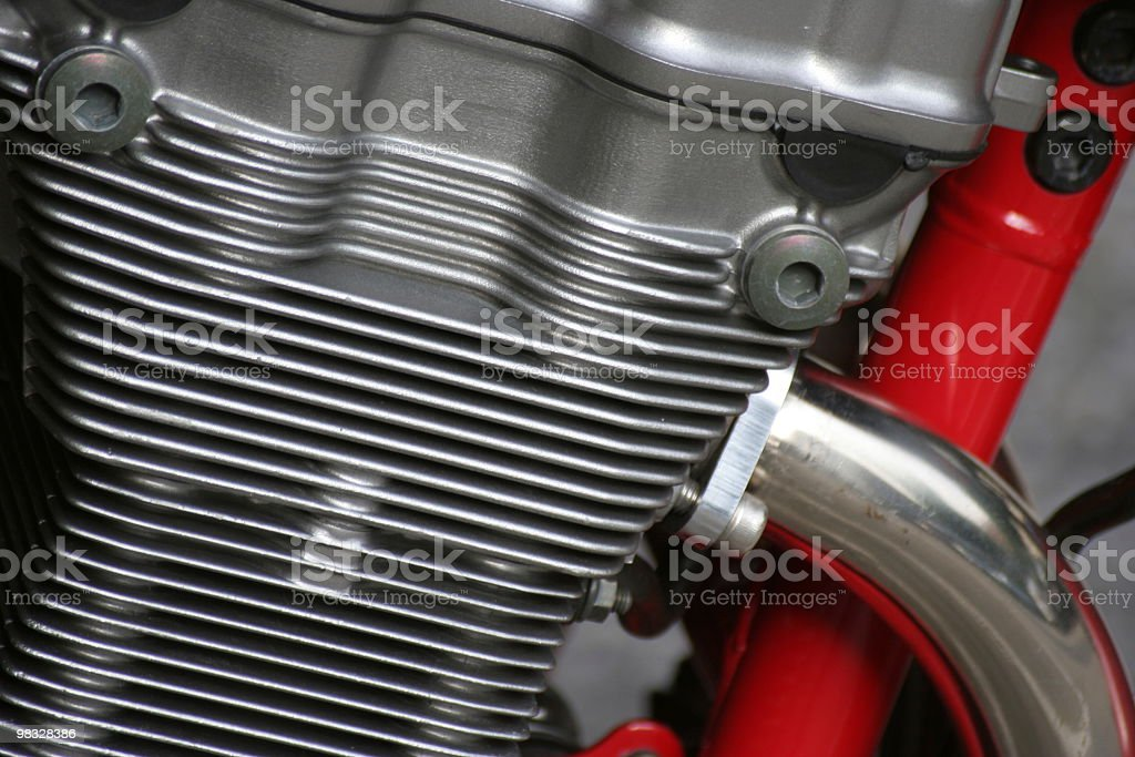 Red and silver metal parts on motorbike royalty-free stock photo