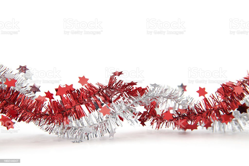 Red and silver tinsel with stars, isolated stock photo