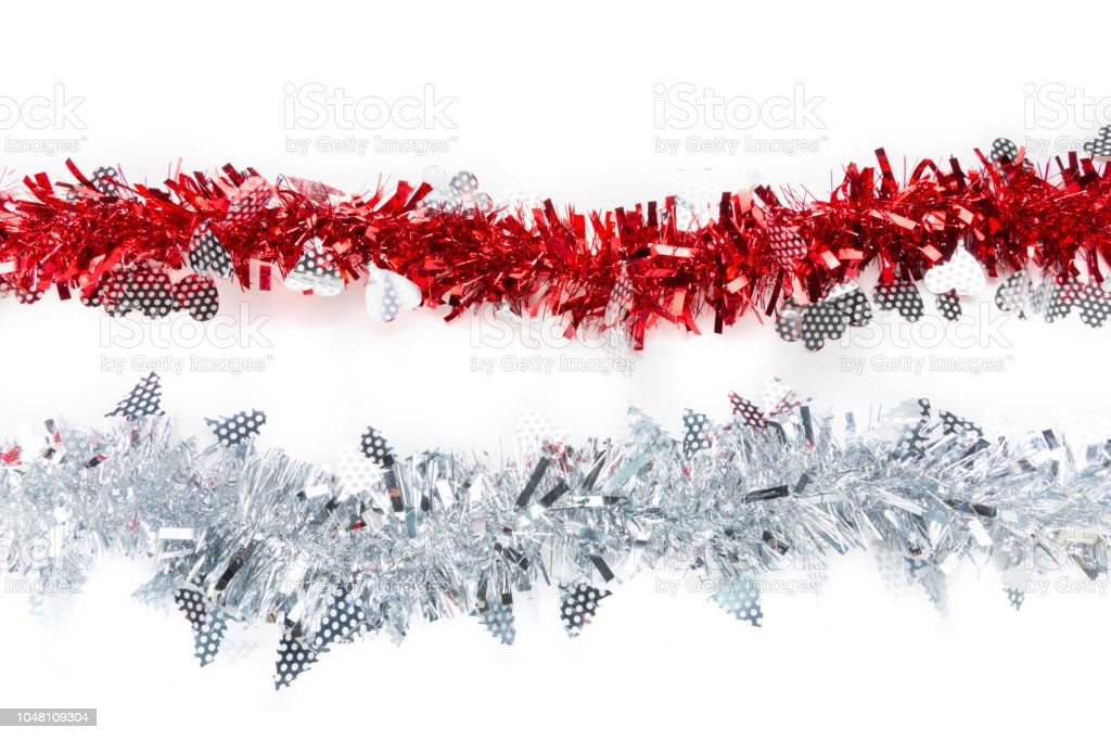 Red and silver white tinsels on white background, Christmas decorative tree or house ornaments for special holiday - foto stock
