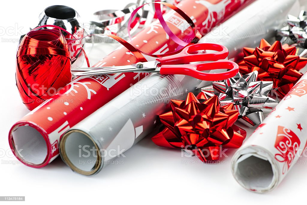 Red and silver wrapping paper rolls on white background stock photo