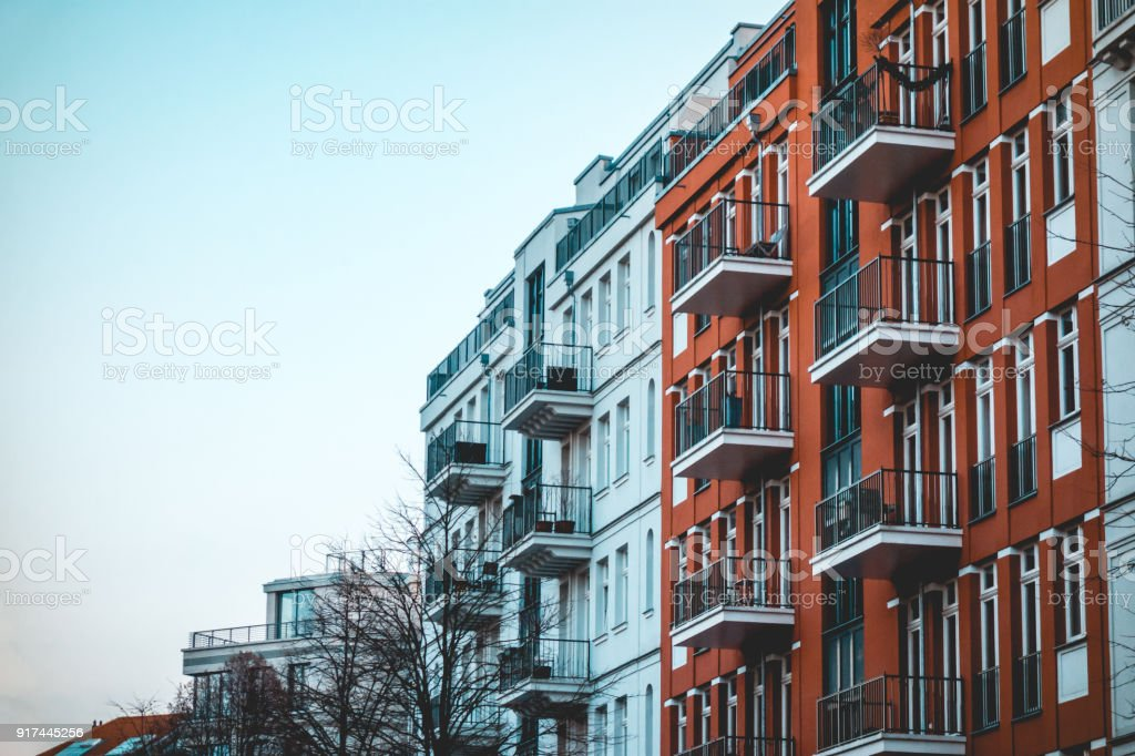 red and white apartments from exterior view in vintage colors stock photo