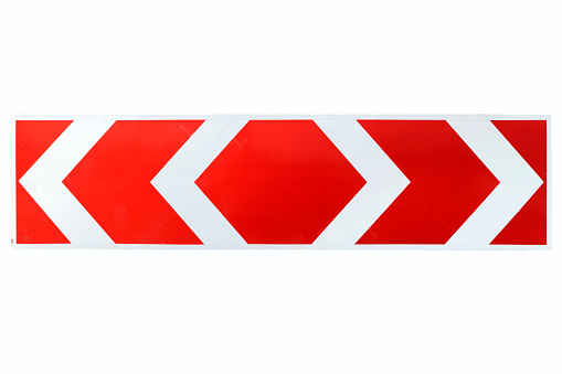 Red and White Arrow Direction Traffic Sign isolated on white.