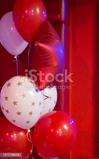 1035635902 istock photo Red and white balloons with stars pattern. Balloon traditional holiday attribute. Every party needs balloons. Happy birthday concept. Celebrate birthday holiday with festive colorful air balloons 1212750151