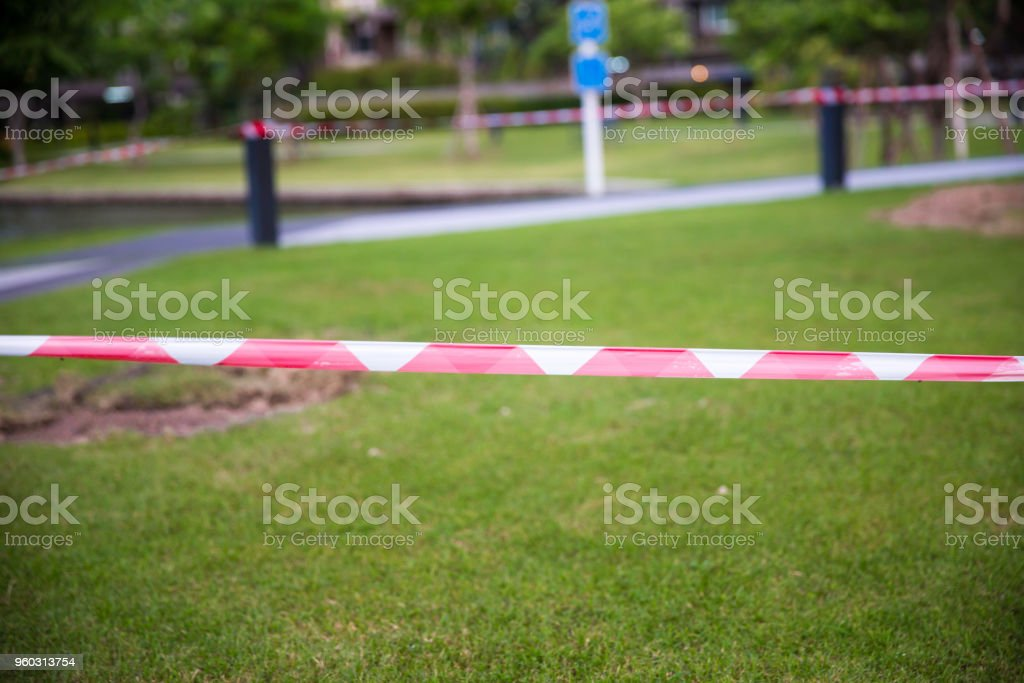Red and white Barricade tape defining border of restricted area of construction work in progress. stock photo