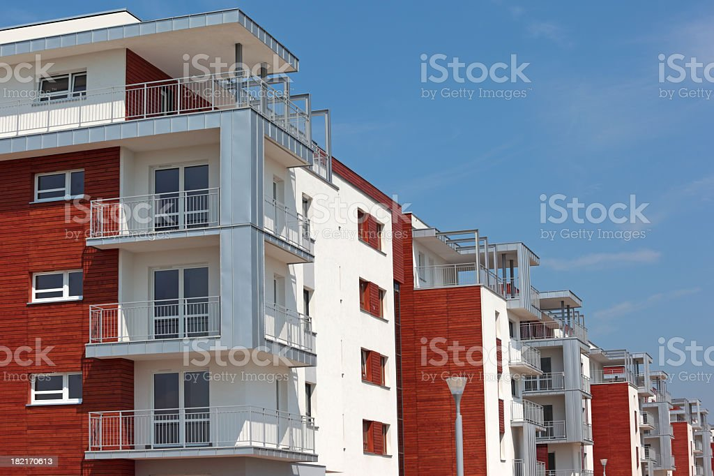 A red and white brick apartment building royalty-free stock photo