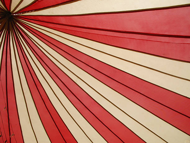 red and white canopy - circus background stock photos and pictures