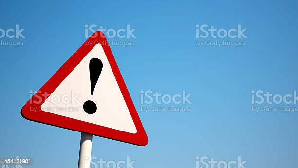 Warning Sign isolated on clean blue sky
