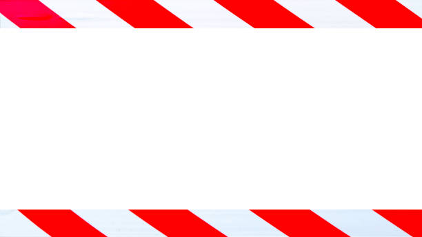 Red and white caution warning tape stock photo