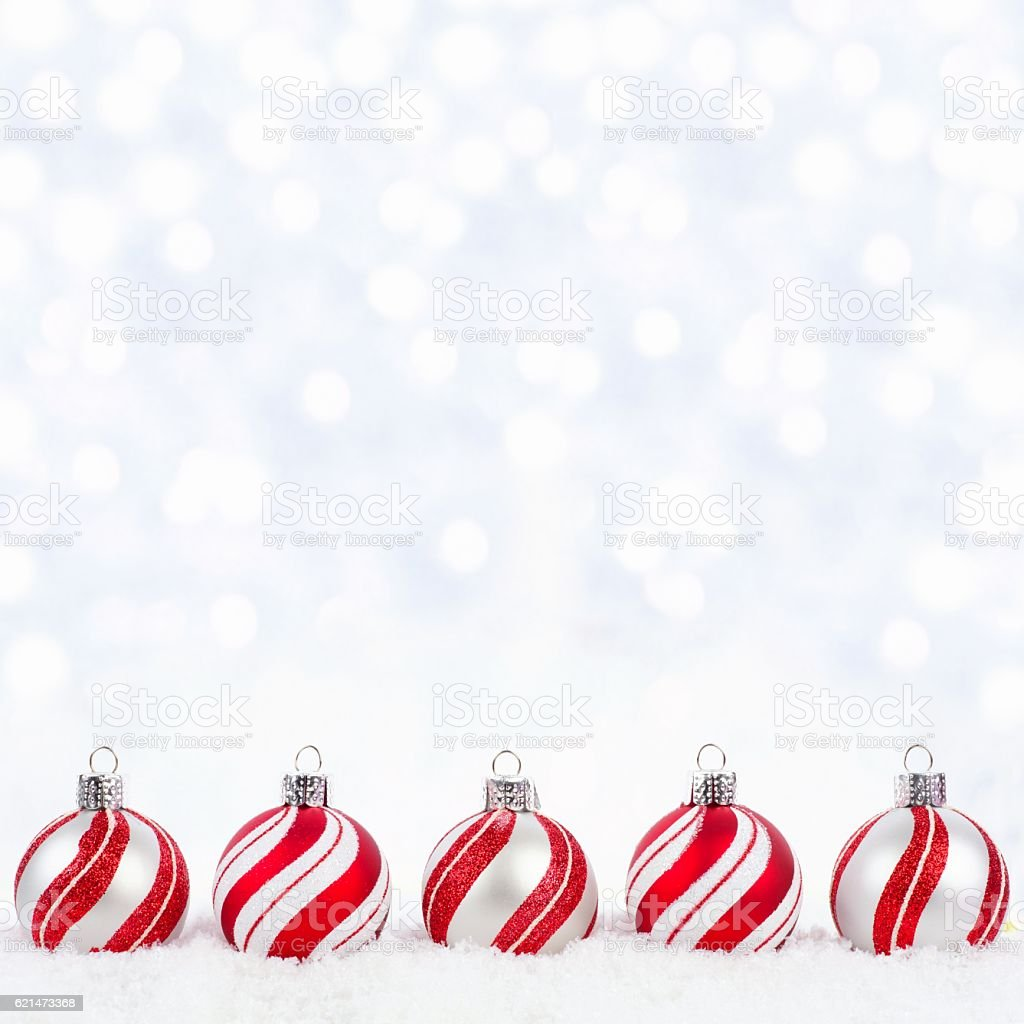 White Christmas Snow Background.Red And White Christmas Ornaments In Snow With Twinkling