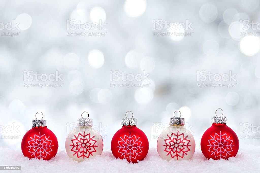 red and white christmas ornaments with twinkling silver background royalty free stock photo - Red And Silver Christmas Ornaments