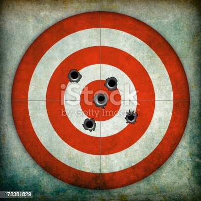 istock Red and white circular target with bullet holes 178381829