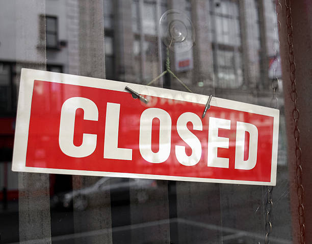 red and white closed sign hanging in a shop window - closed stock photos and pictures