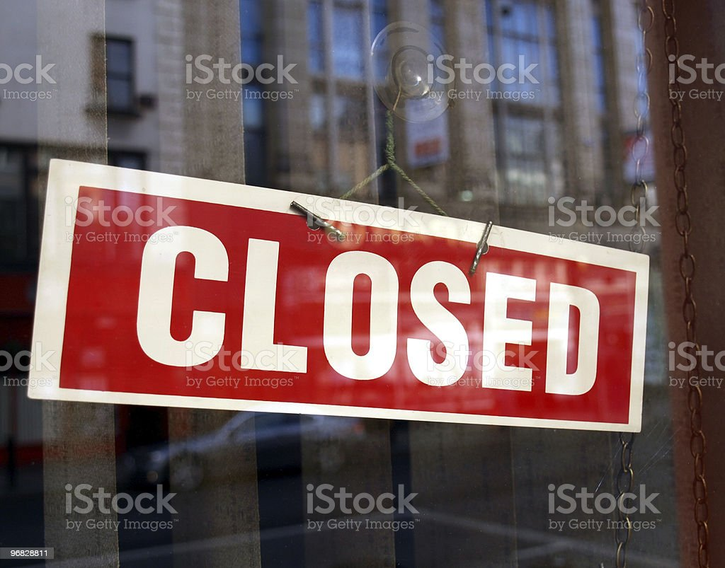 A red and white closed sign on a business window stock photo