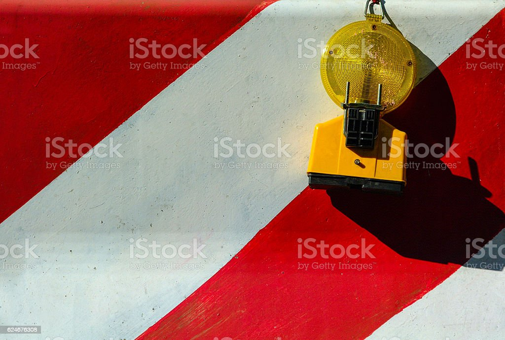 Red and White Concrete Jersey Barrier with Warning Light stock photo