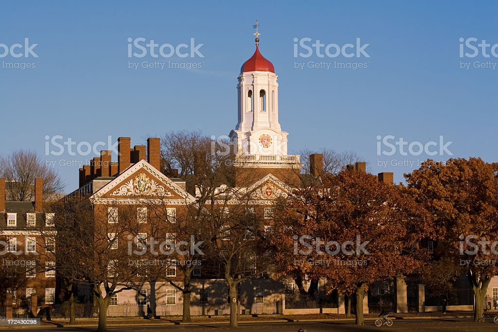 Red and white cupola on a grand brick building in autumn stock photo