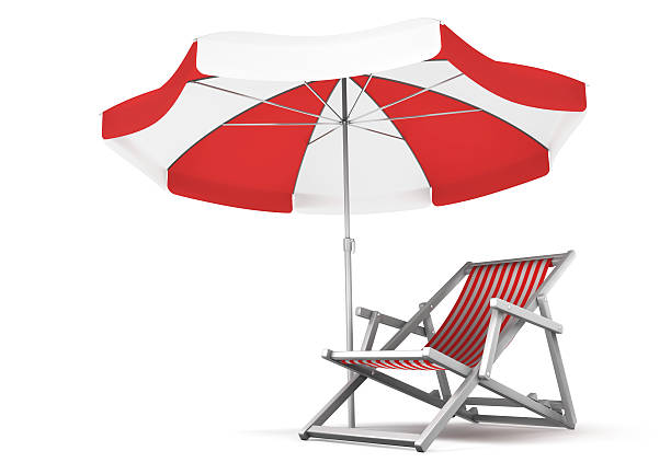 Red and white deck chair and umbrella set stock photo