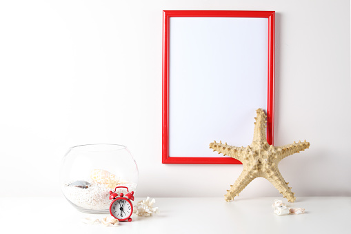 518847146 istock photo Red and white frame poster with plant in pot on table. 955828000