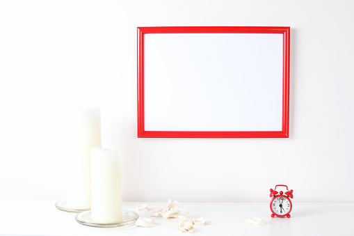 518847146 istock photo Red and white frame poster with plant in pot on table. 955828332