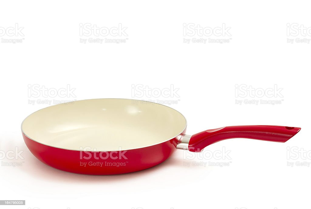 Red and white frying pan on a white background stock photo
