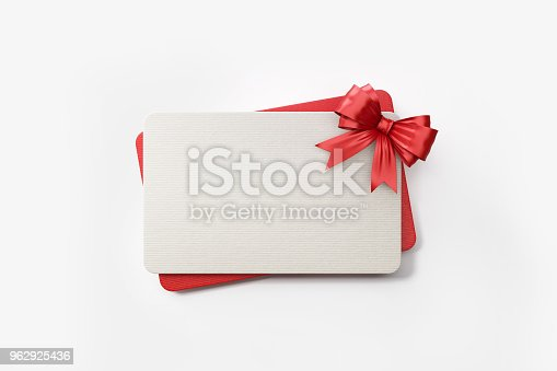 Red and white gift card with red colored bow tie on white background. Horizontal composition with clipping path and copy space.