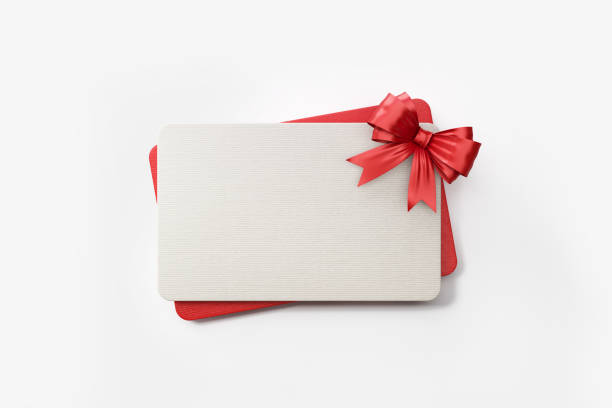 Red And White Gift Cards With Red Colored Bow Tie On White Background Red and white gift card with red colored bow tie on white background. Horizontal composition with clipping path and copy space. gift card stock pictures, royalty-free photos & images