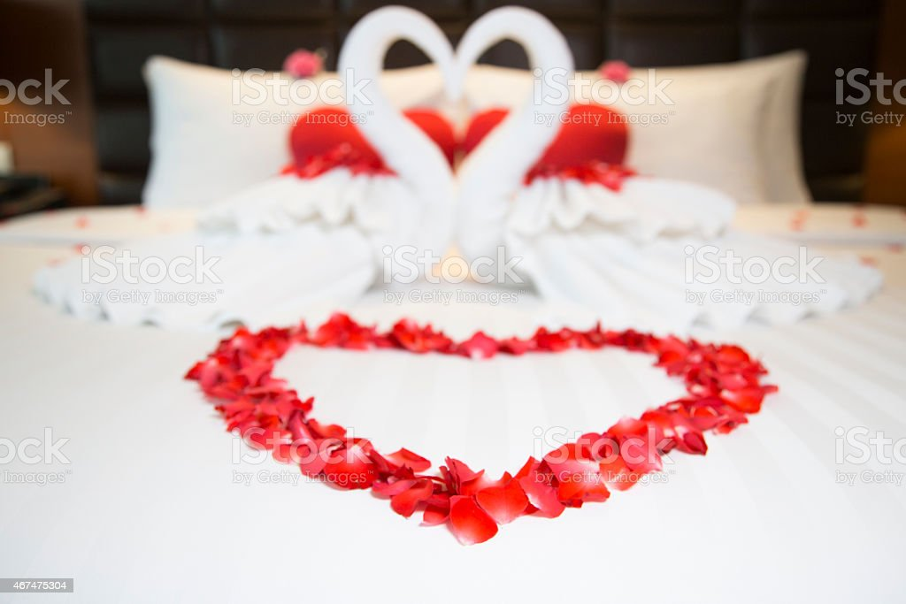 Red and white heart decorations on bed stock photo