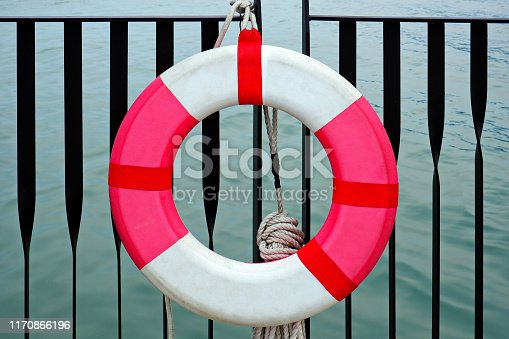 Red and White Lifebuoy / Safety Torus Hanging on the Pier