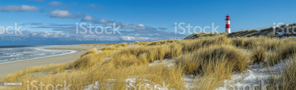 Red And White Lighthouse On Sand Dune In Snow Island Sylt Germany