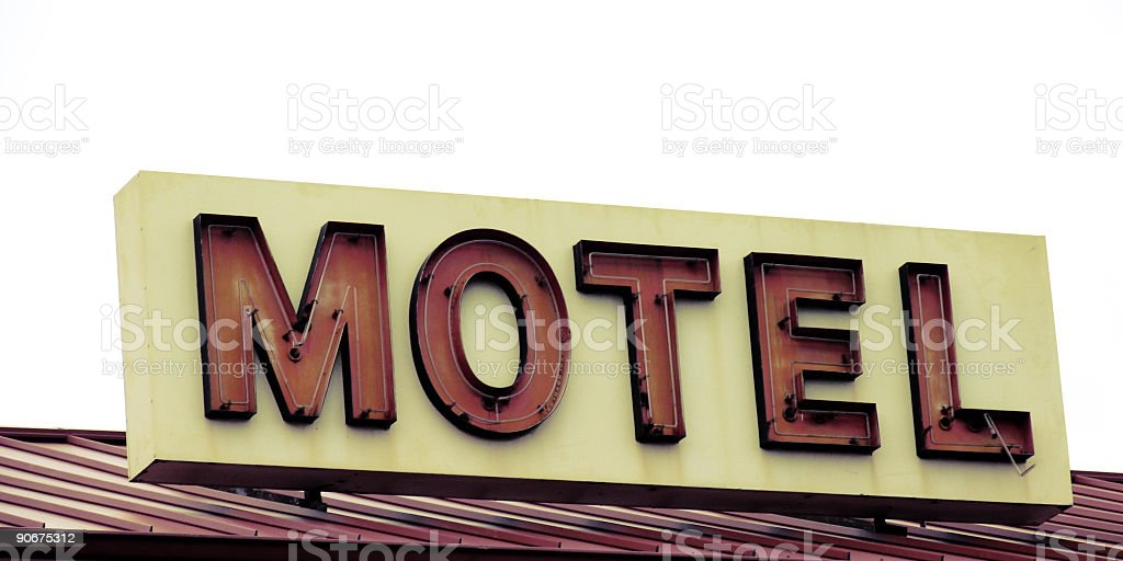 Red and White Motel Sign on Roof royalty-free stock photo