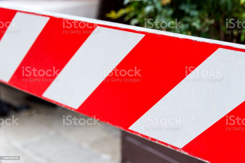 Red and white non-entry barrier. Restricted area. stock photo