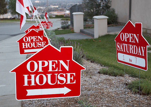 Red and white open house signs Red and white open house sign close-up with more signs in the background. real estate sign stock pictures, royalty-free photos & images