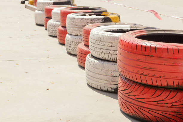 Red and white painted tires are alternately placed in rows. Red and white painted tires are alternately placed in rows. alternately stock pictures, royalty-free photos & images