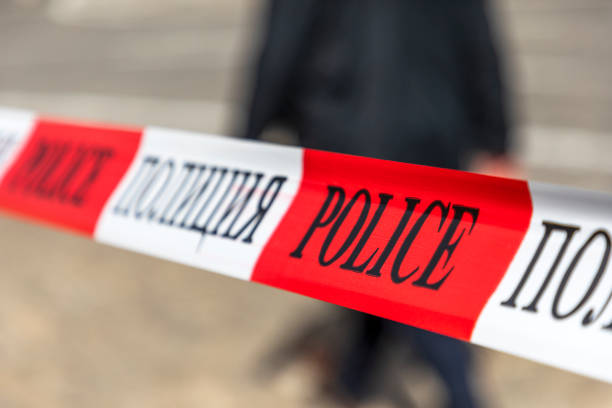 Red and white police line tape. stock photo