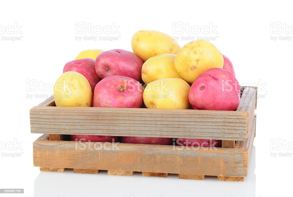 Red and White Potatoes in Wooden Crate stock photo