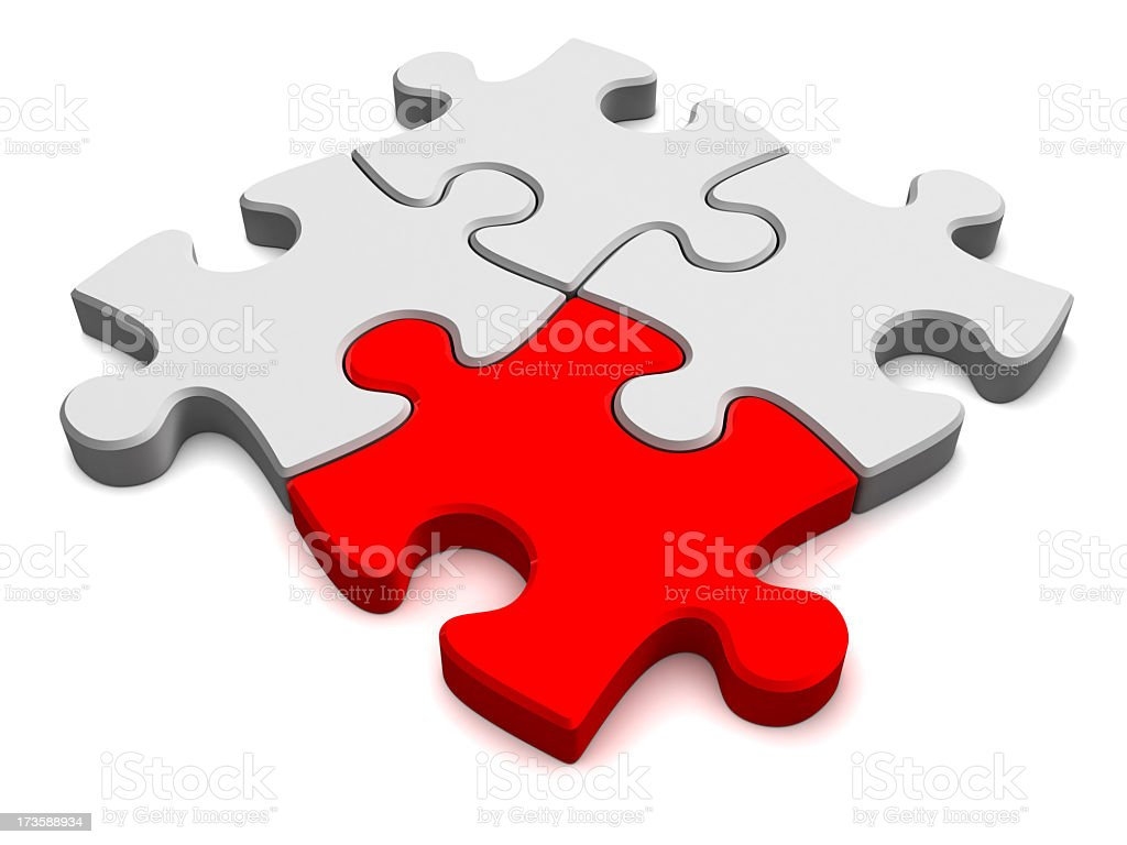 Red and white Puzzle pieces symbolizing teamwork royalty-free stock photo