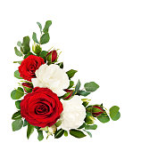 istock Red and white rose flowers with eucalyptus leaves in a corner arrangement 958321436