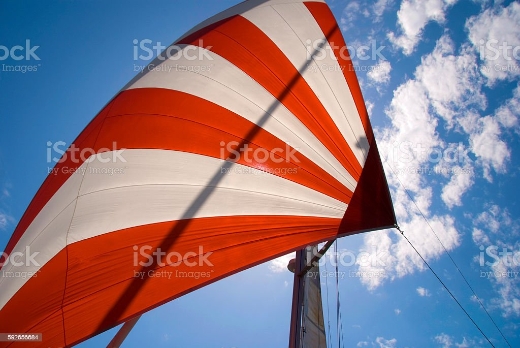 red and white sail stock photo