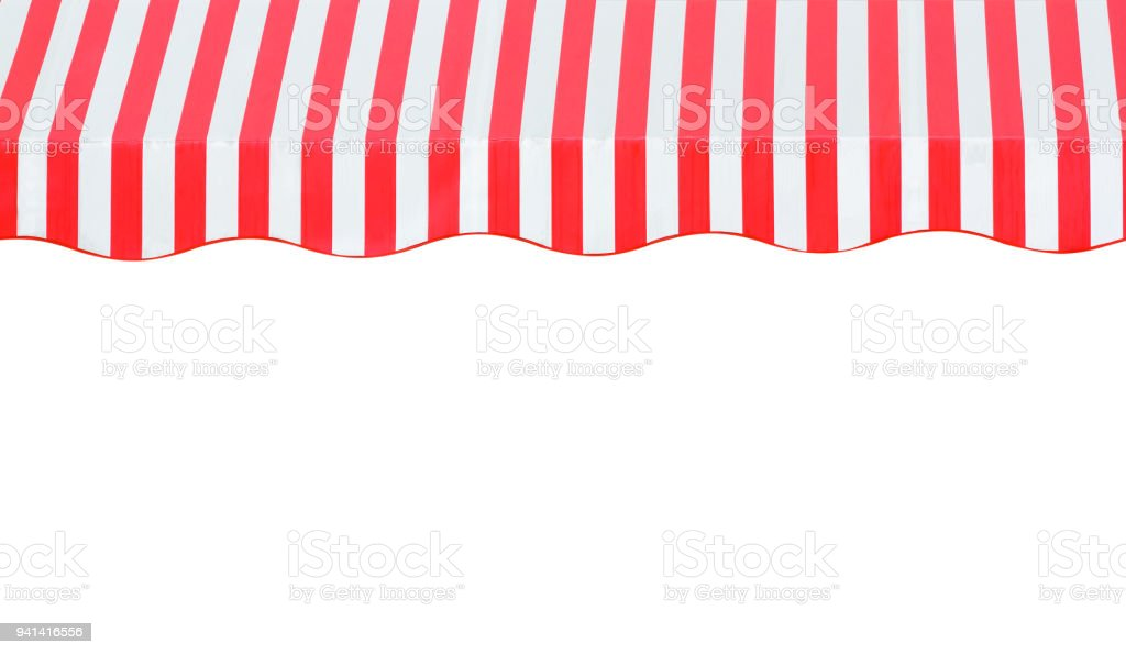 red and white strip awning in front of the shop stock photo