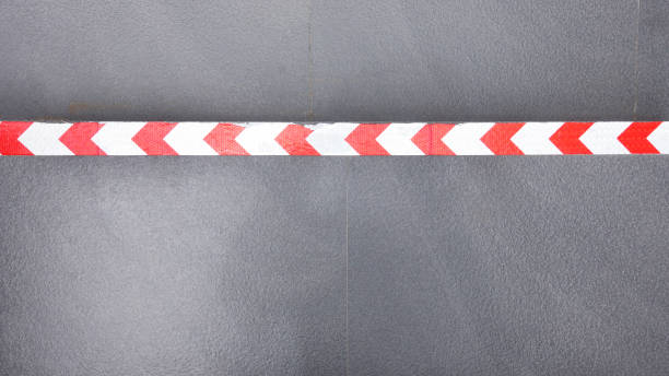 Red and white striped barrier tape line – zdjęcie