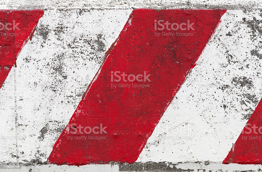 Red And White Striped Concrete Road Barrier Stock Photo - Download