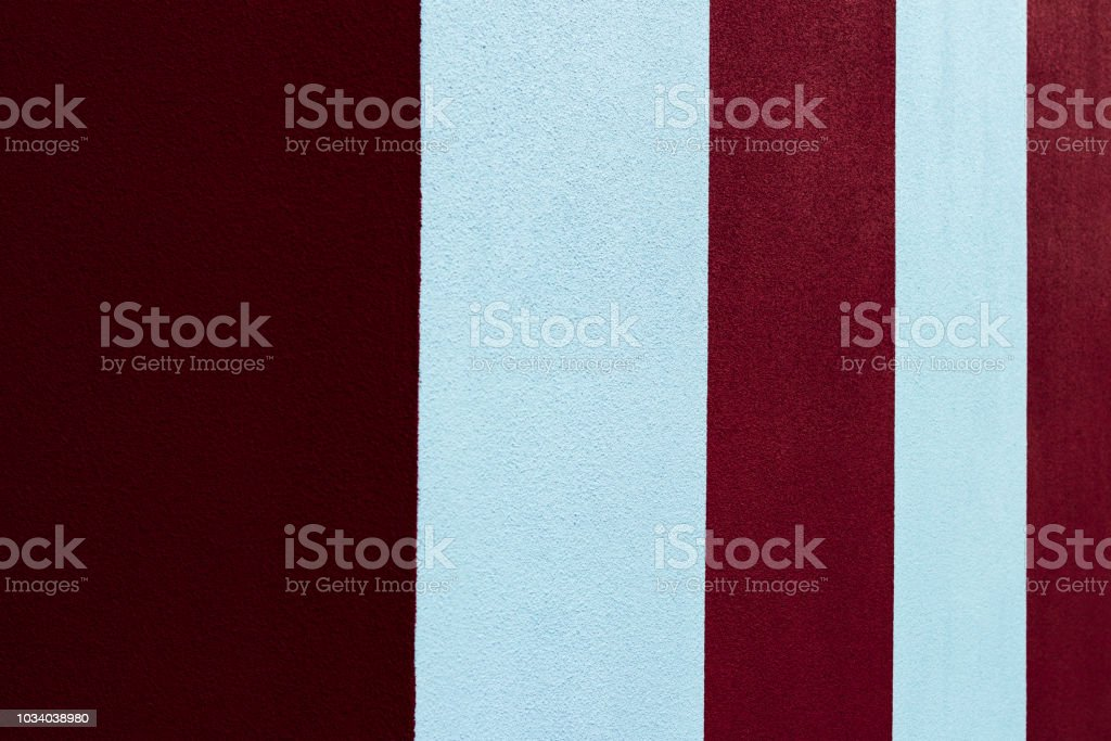 Red and white striped painted wall stock photo
