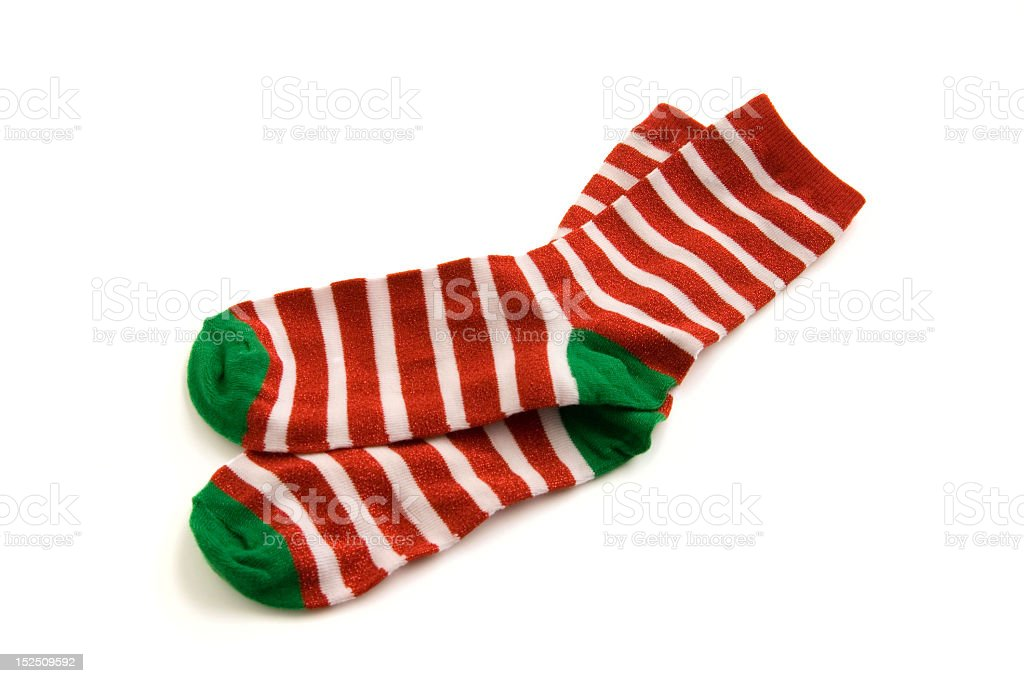 Red and white striped socks with green toes and heels stock photo