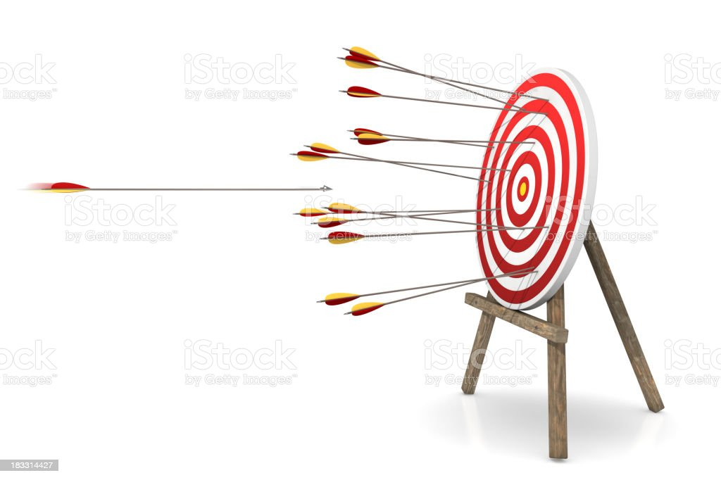 A red and white target riddled with arrows  stock photo