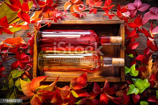 istock Red and white Wine bottles in a autumn wooden box 1194633131