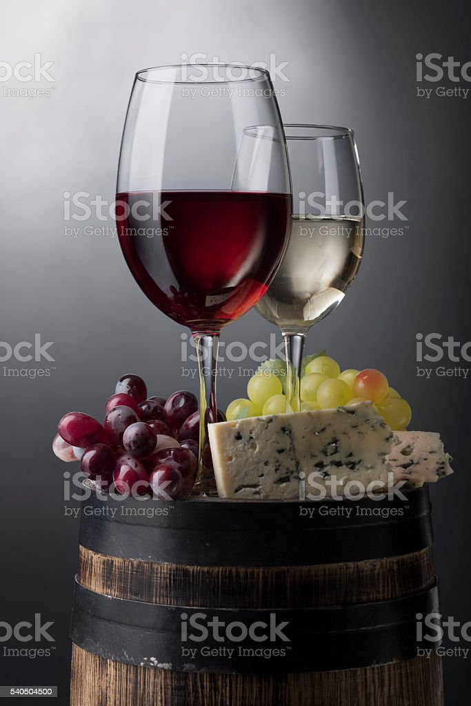 Red and white wine glass on barrel stock photo