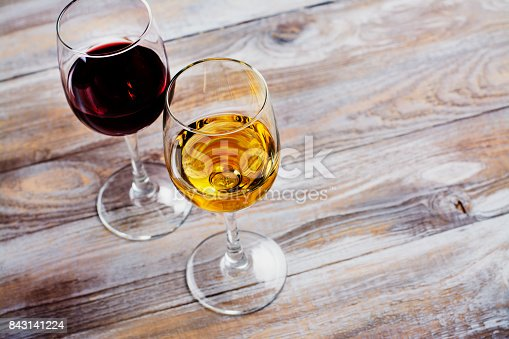 924487256 istock photo Red and white wine in glasses with grapes 843141224