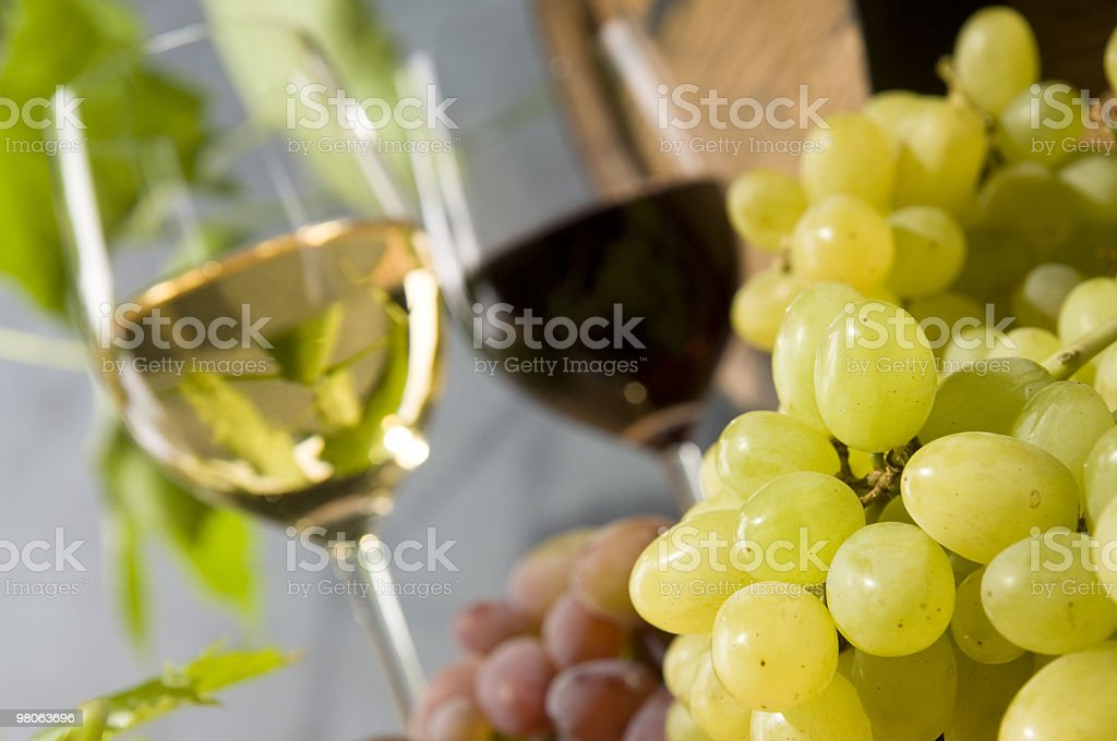 Red and White Wine with Grapes royalty-free stock photo