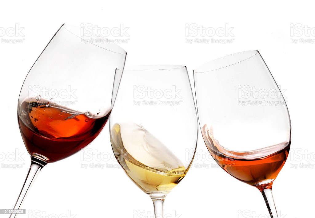 red and white wine with splash, cheers close up  isolated stock photo