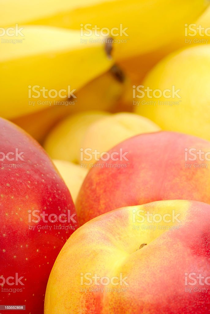 red and yellow background of fresh fruits royalty-free stock photo